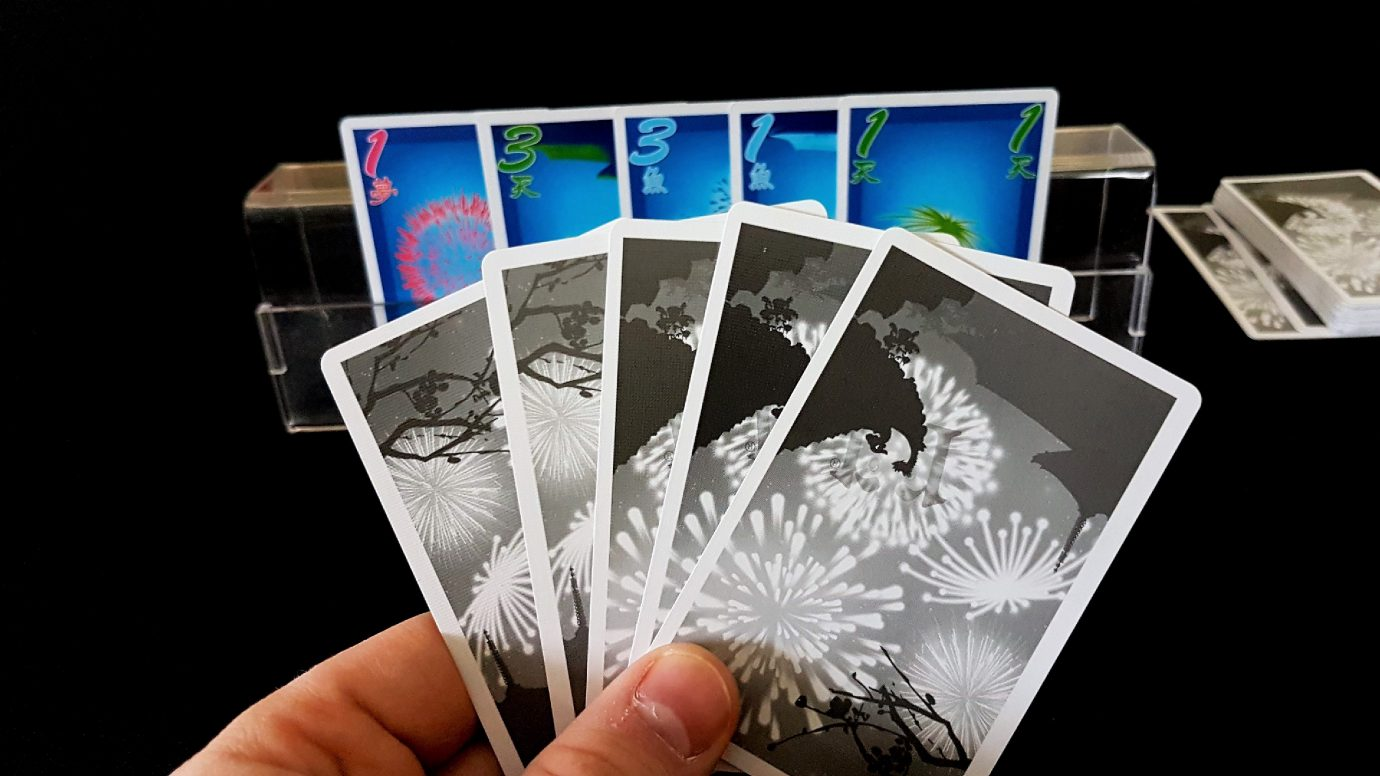 Hanabi cards in a holder