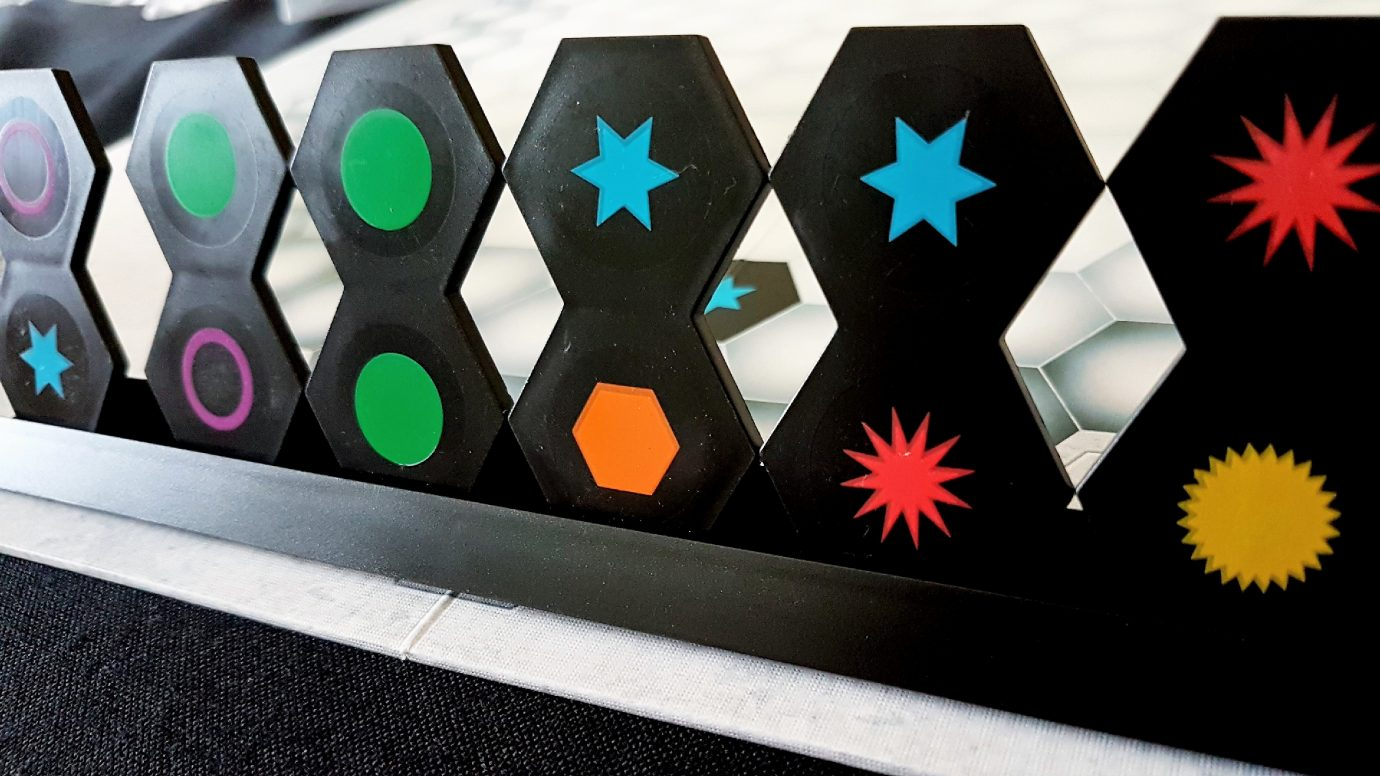 A tile rack with some hexes in it