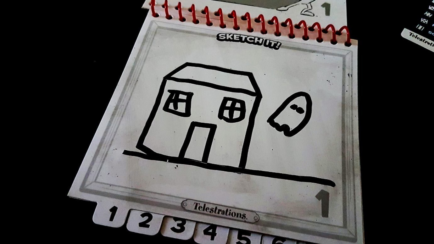 A ghost drawn beside a house in Telestrations