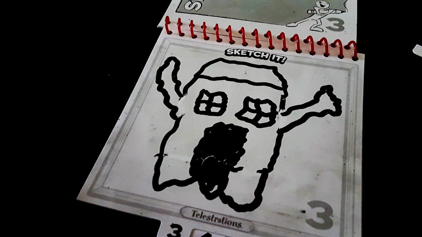 A drawing of a house that is a ghost in Telestrations