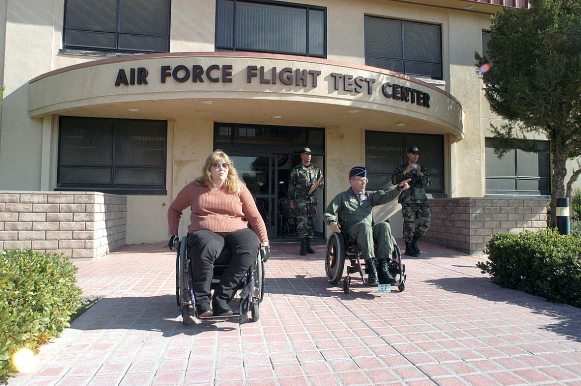 Air Force Flight Test Center commander (right), and Donna Smith, 412th Test Wing engineering directorate senior resource advisor, take an outing together to experience the difficulties being in a wheelchair when accomplishing daily activities