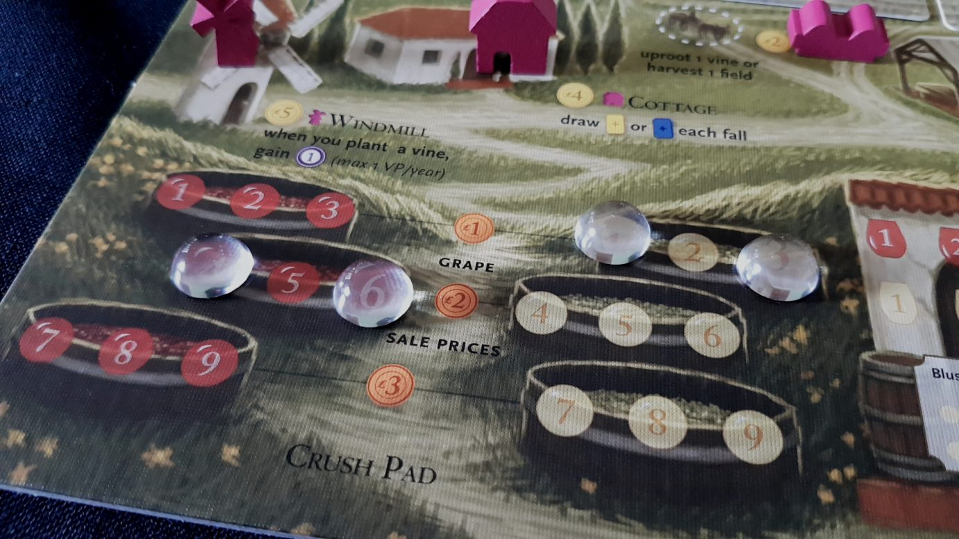 Tokens in the Viticulture crush pads