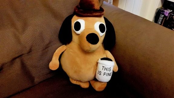 A plushie of the 'This is Fine' dog